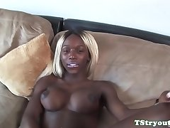 Bigtitted ebony trans tugs cock at casting