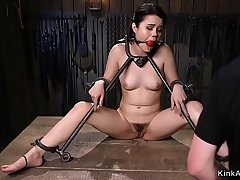 Babe locked in metal device bondage