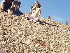Hot blonde naked on beach